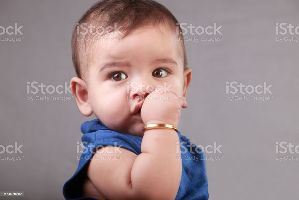 Portrait of a thumb sucking baby royalty-free stock photo