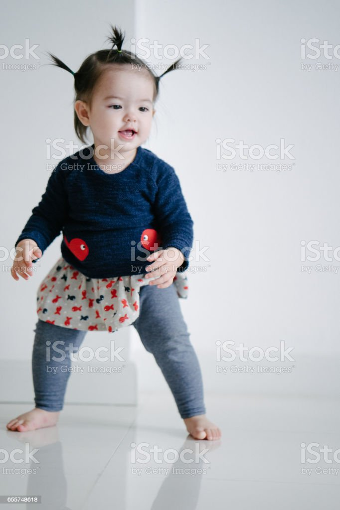 Portrait of a toddler girl standing stock photo