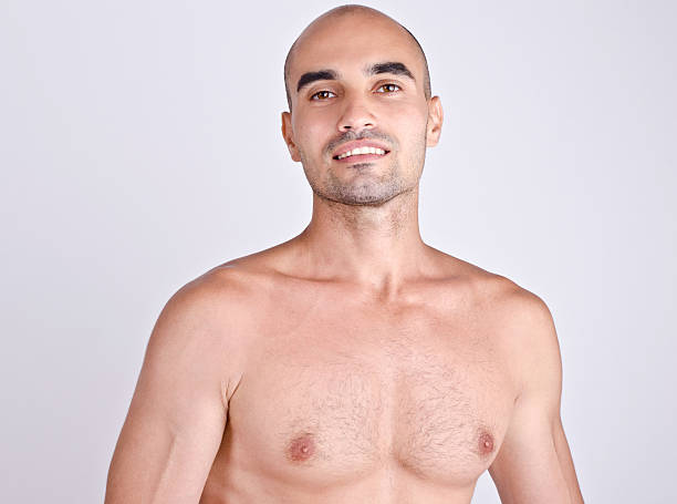Portrait of a topless man smiling. stock photo