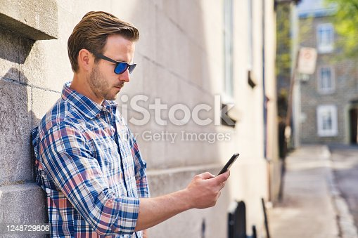 istock portrait of a trendy young man in the city 1248729806