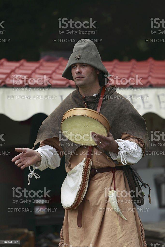Portrait of a troubadour on stilts stock photo