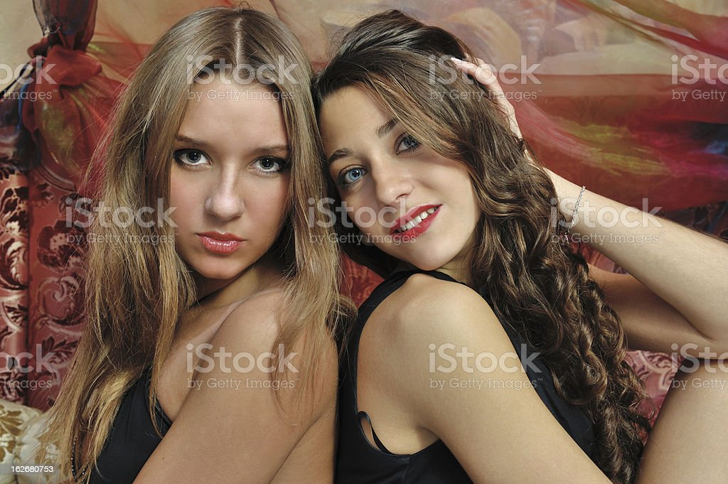 Portrait of a two beautiful women in luxury interior. royalty-free stock photo