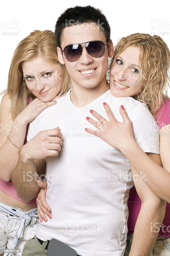 Portrait of a two cheerful blonde women with young man stock photo
