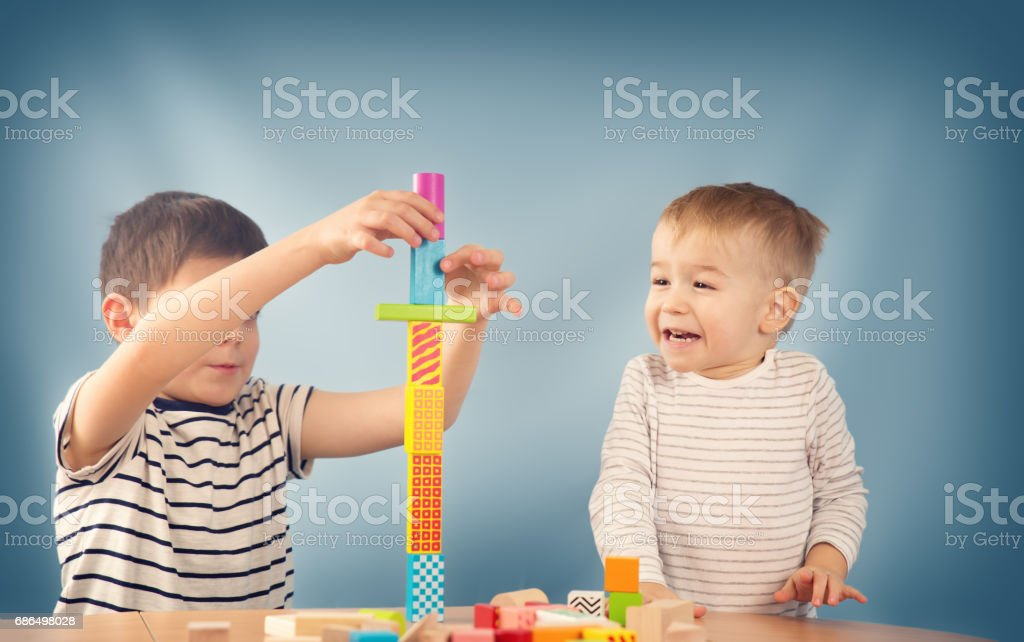 Portrait of a two years old child sitting at the table stock photo