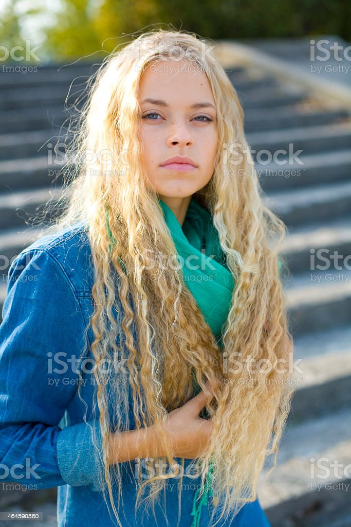 portrait of a very beautiful young blond woman outdoors stock photo