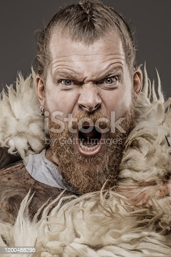 Portrait of an individual snowy Viking warrior king alone in studio shoot
