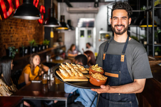 Portrait of a waiter in a cafe in Buenos Aires stock photo