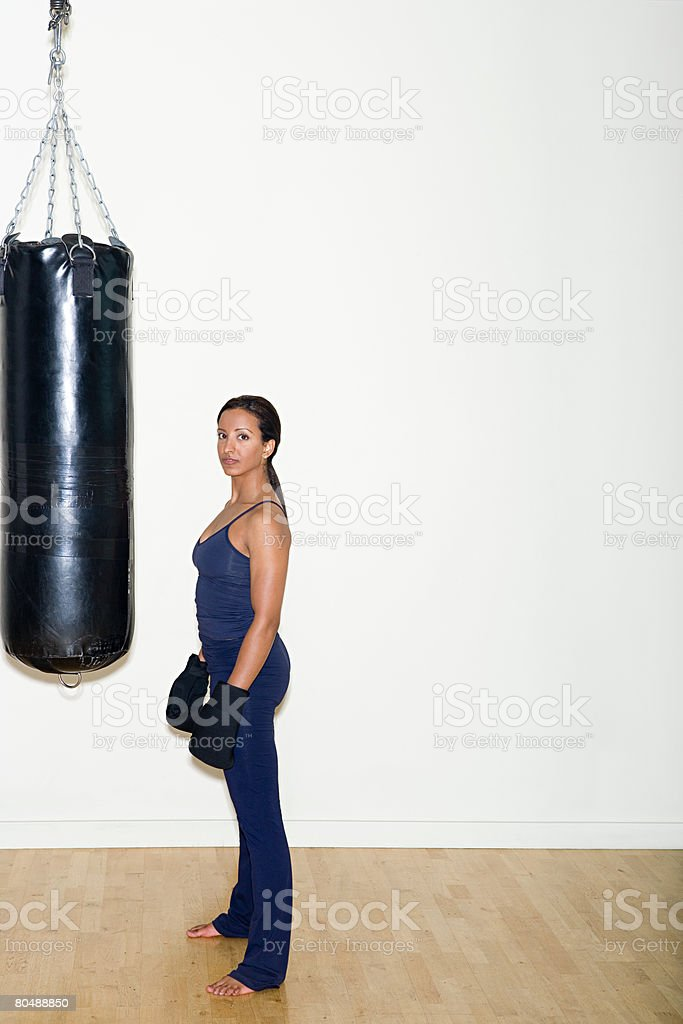 Portrait of a woman and a punch bag 免版稅 stock photo