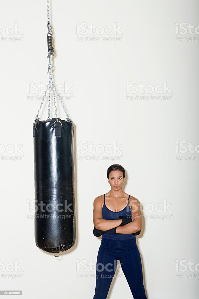 Portrait of a woman and a punch bag royalty-free 스톡 사진
