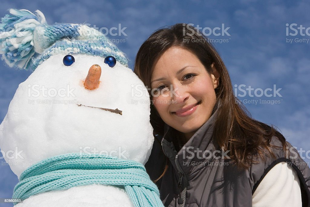 Portrait of a woman and a snowman royaltyfri bildbanksbilder