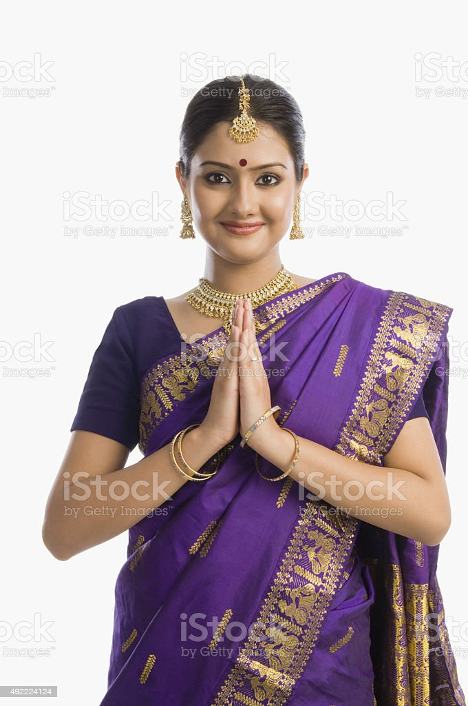 Portrait of a woman greeting in mekhla stock photo