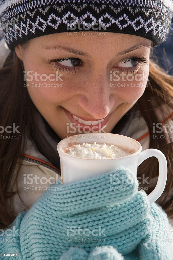 Portrait of a woman holding a cup of hot chocolate royaltyfri bildbanksbilder
