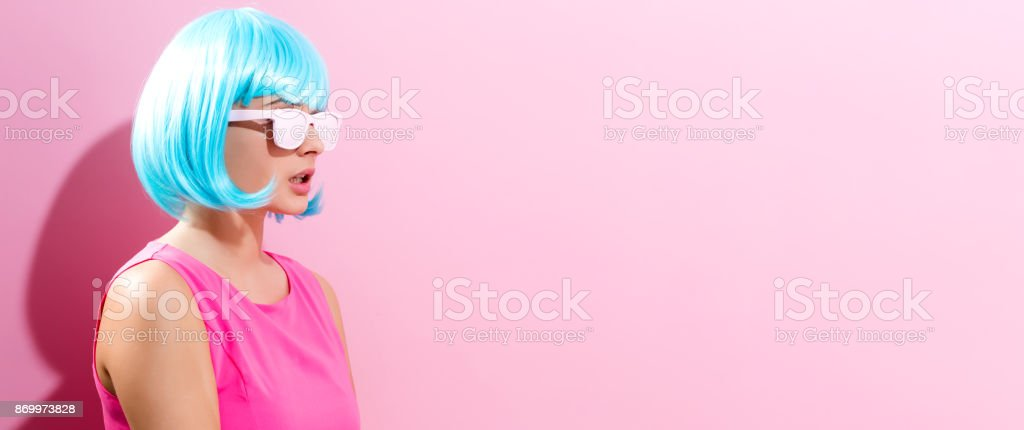 Portrait of a woman in a bright blue wig stock photo