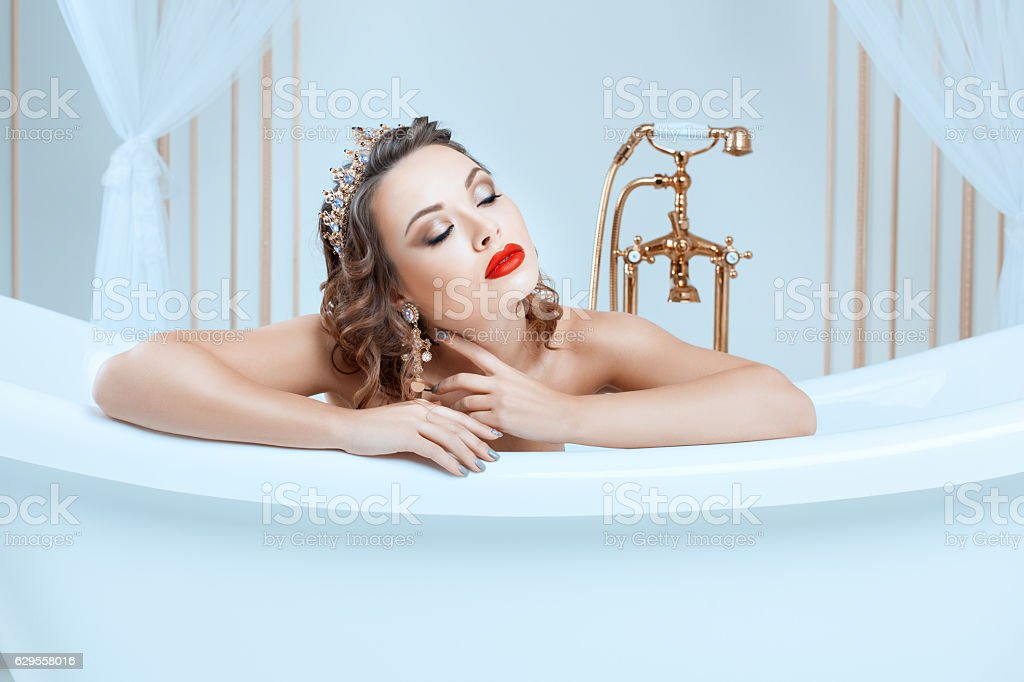 Portrait of a woman in bath. stock photo