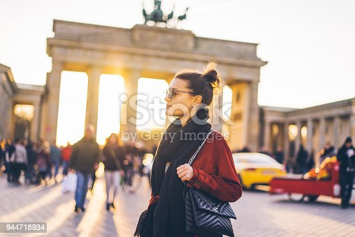 Portrait of a young woman in front of Brandenburger Tor in Berlin, Germany at sunset