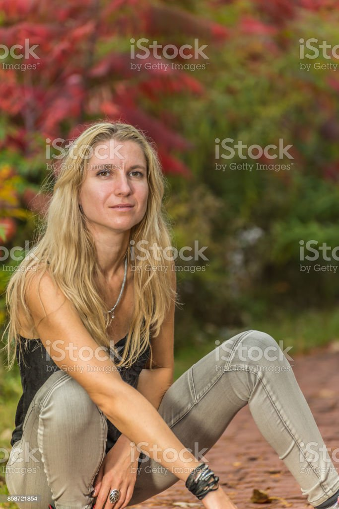 Portrait of a woman in park stock photo