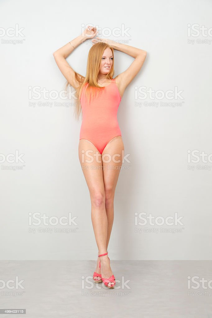 Portrait of a woman in red bodysuit stock photo