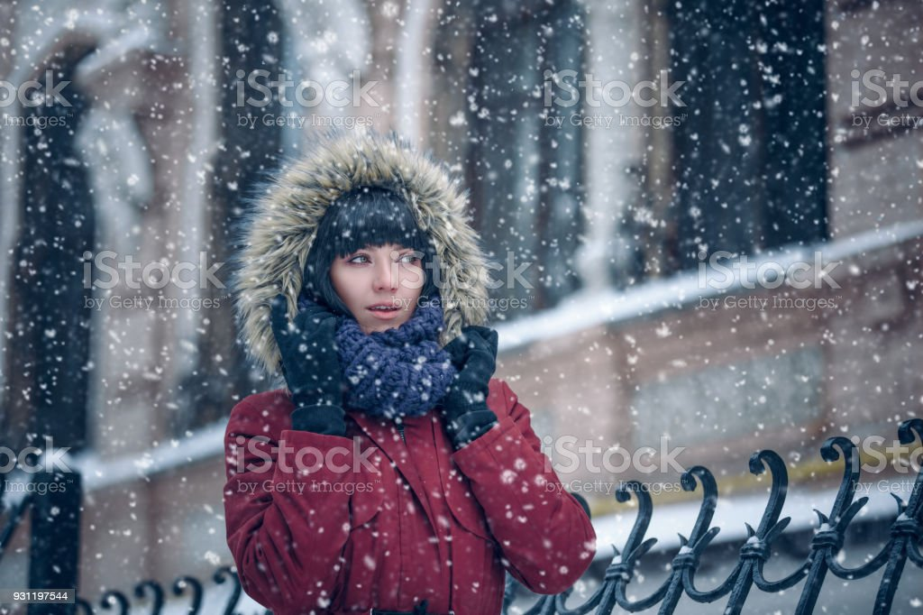 Portrait of a woman in the snow stock photo