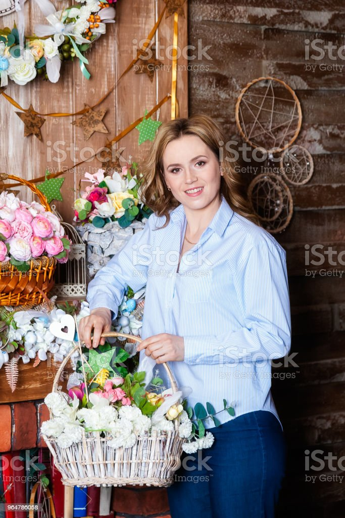 Portrait of a woman looking at the camera and smiling royalty-free stock photo