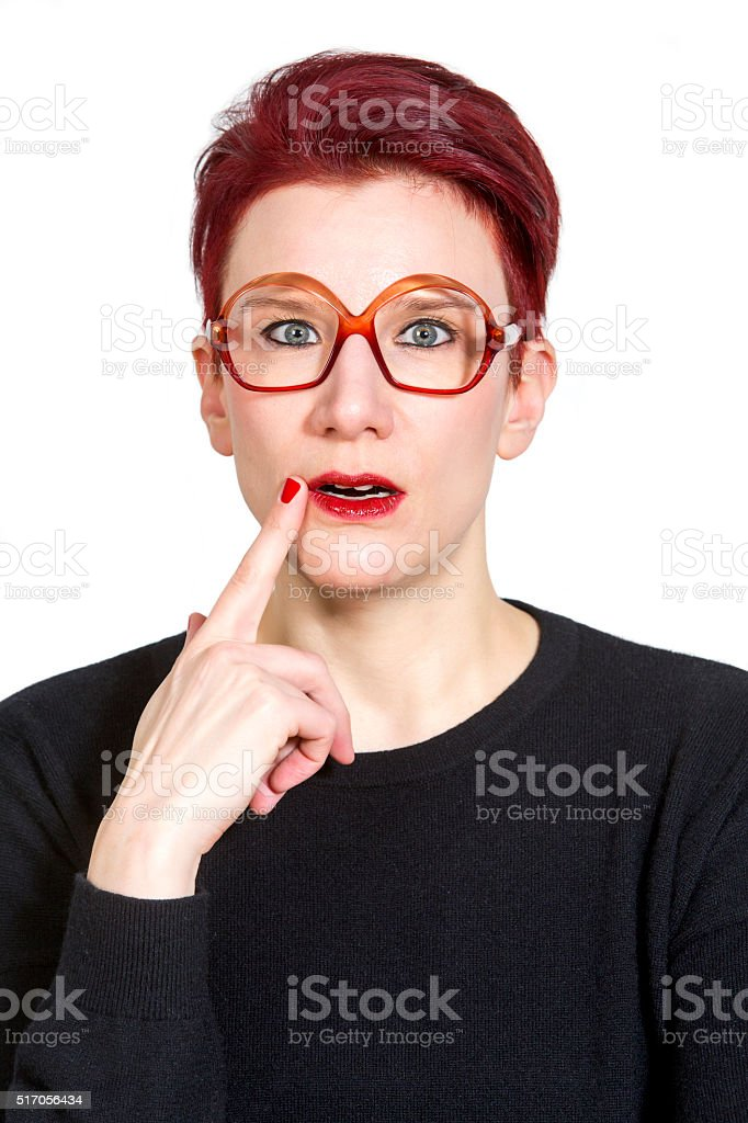 portrait of a woman looking clueless stock photo
