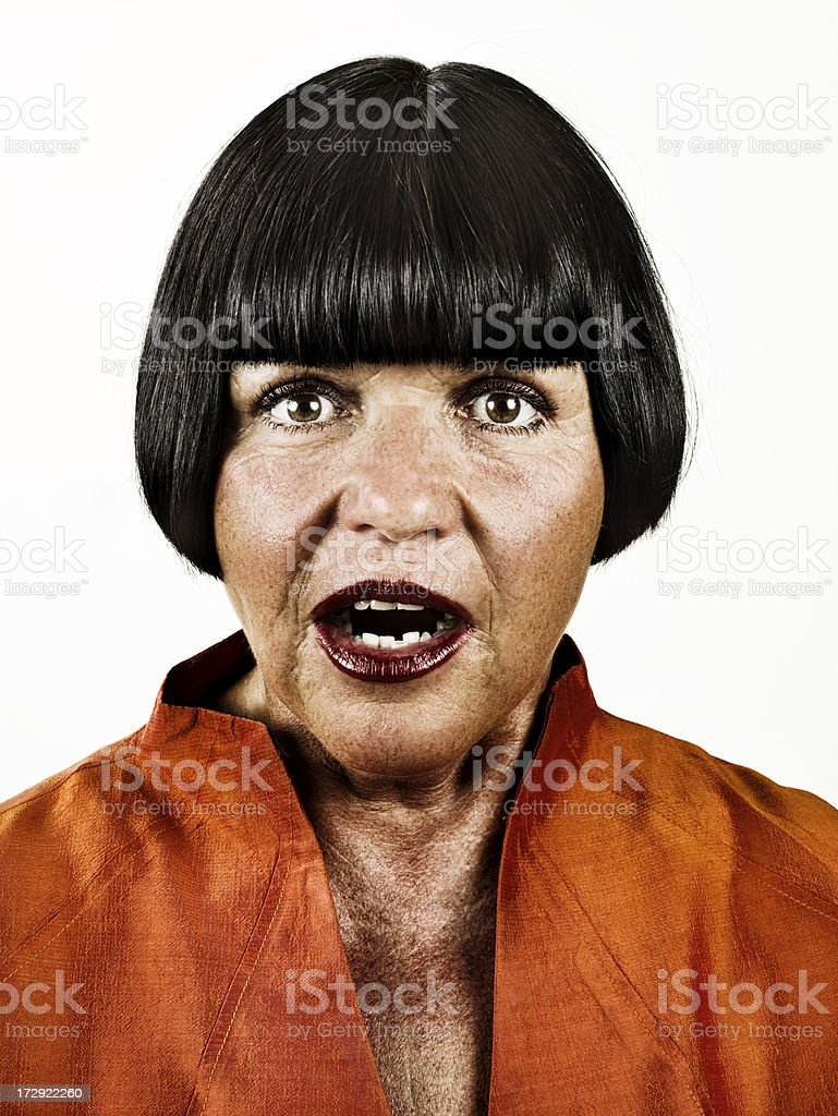 Portrait of a woman looking surprised stock photo