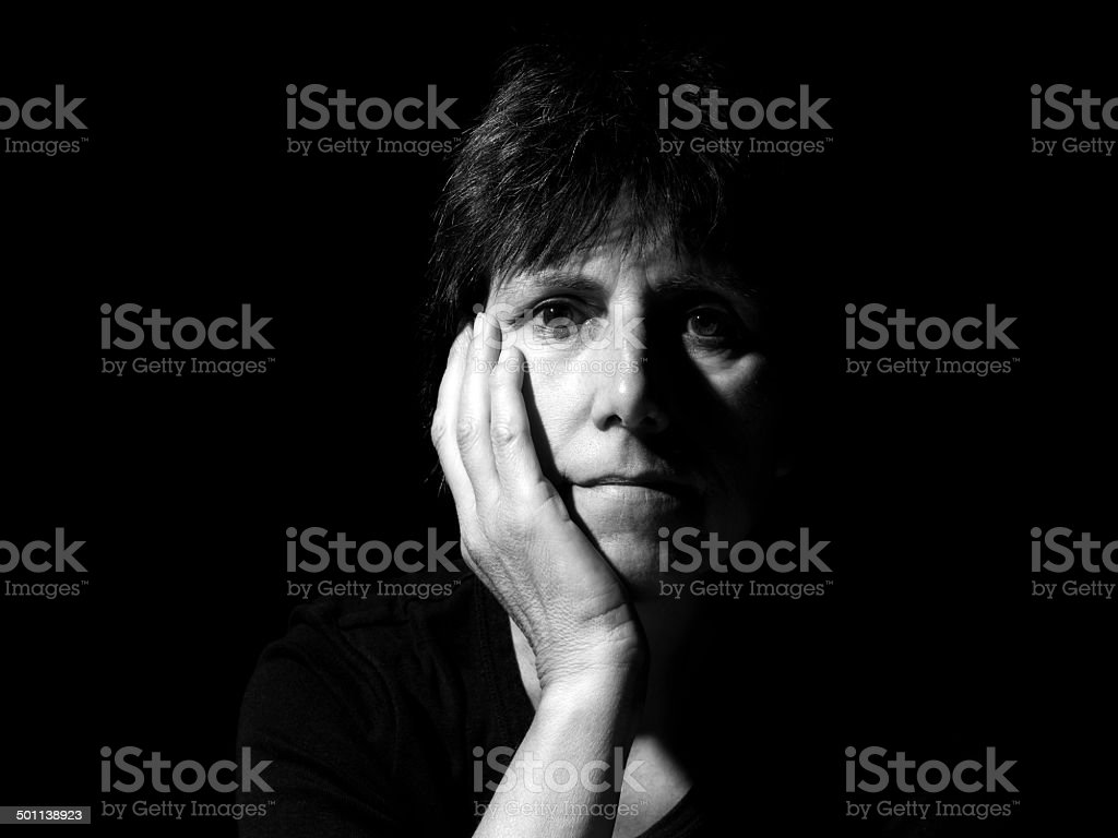 Portrait of a woman - middle aged, looking at camera. stock photo