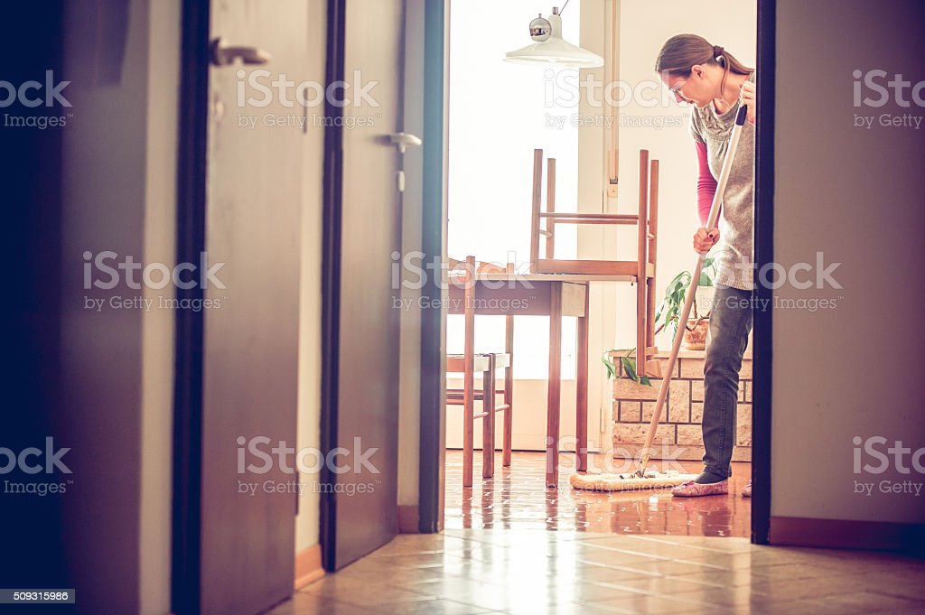 Portrait of a Woman Mopping Floor stock photo