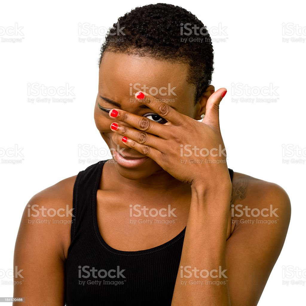 A portrait of a woman peeking through her hand royalty-free stock photo