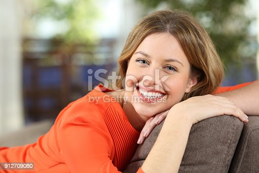 istock Portrait of a woman posing looking at you at home 912709080