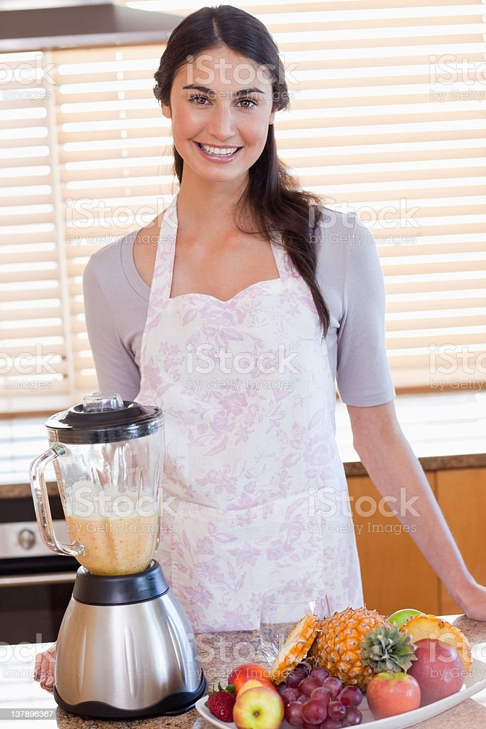Portrait of a woman posing with one blender royalty-free stock photo