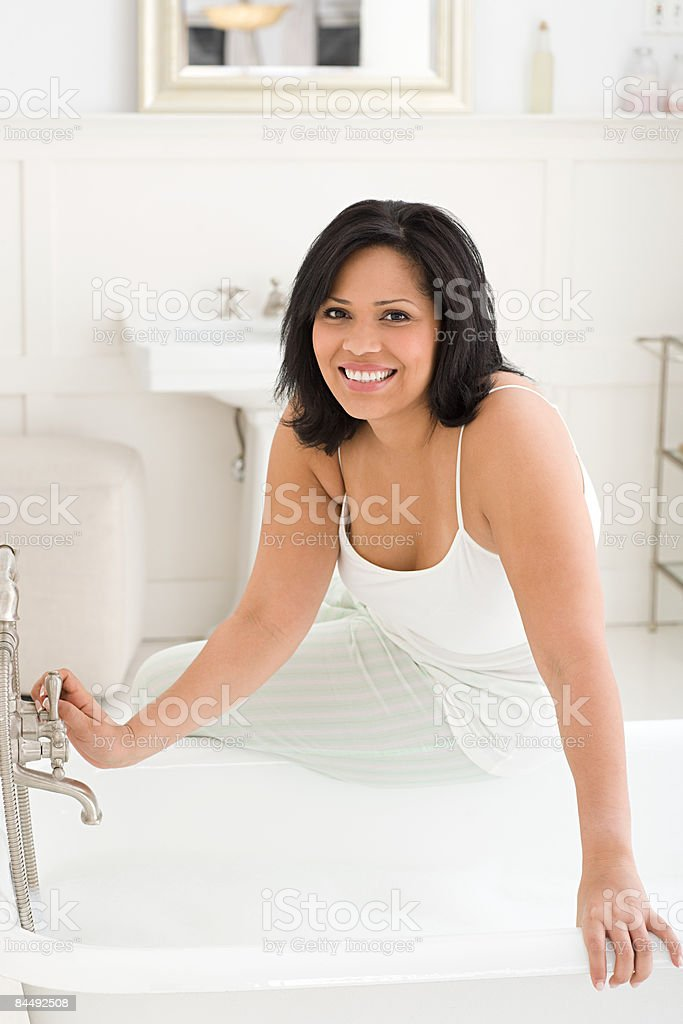 Portrait of a woman running a bath royalty-free stock photo