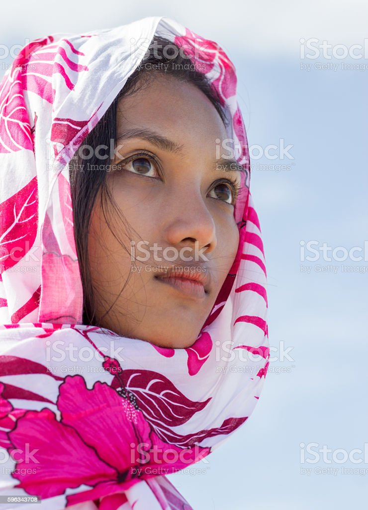 Portrait of a woman shrouded in a scarf royalty-free stock photo