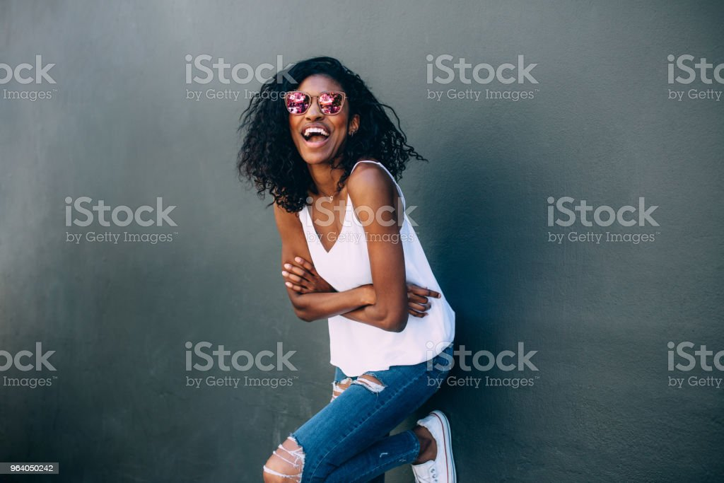Portrait of a woman standing against a wall - Royalty-free Adult Stock Photo