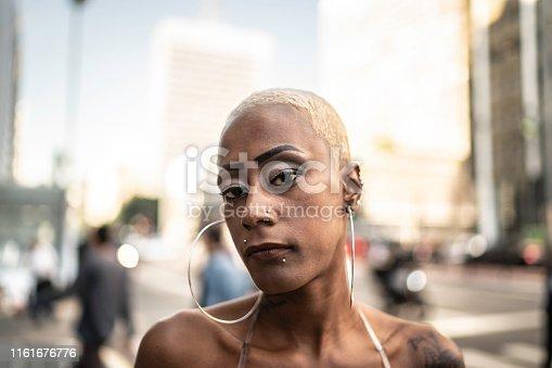 Portrait of a woman walking in a city