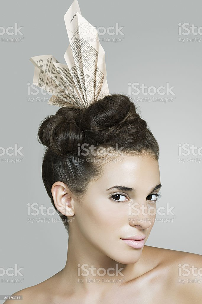 Portrait of a woman wearing a newspaper accessory royalty-free 스톡 사진