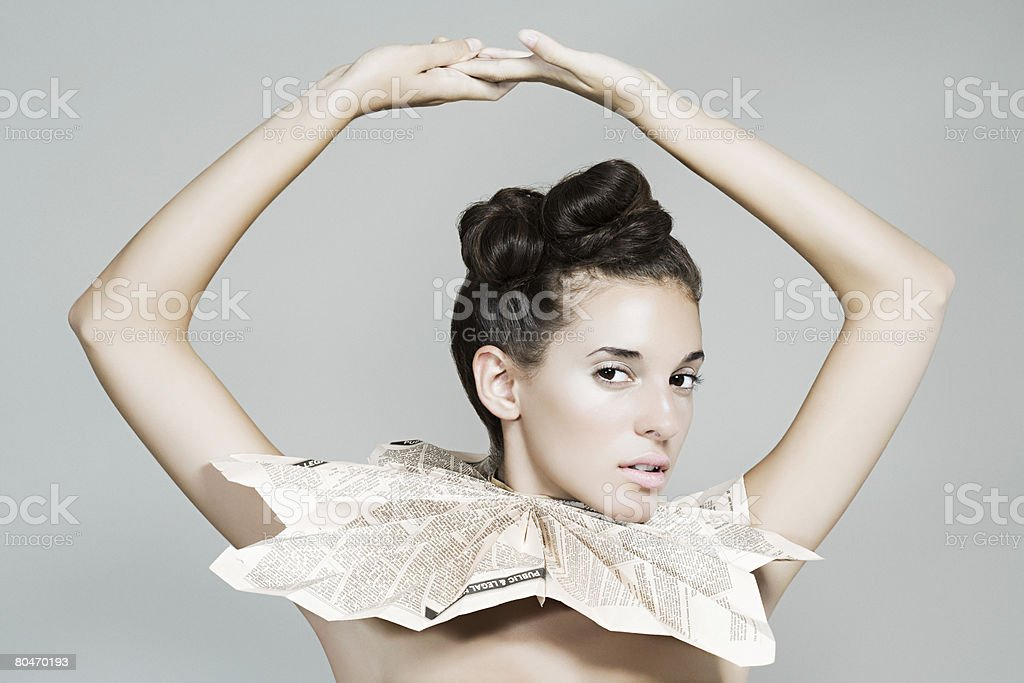 Portrait of a woman wearing a newspaper collar stock photo