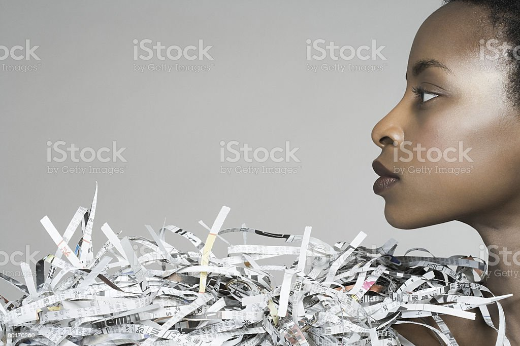 Portrait of a woman wearing newspaper accessory royalty-free stock photo