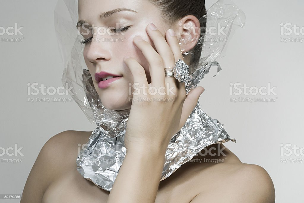 Portrait of a woman wearing recycled accessories royalty-free 스톡 사진