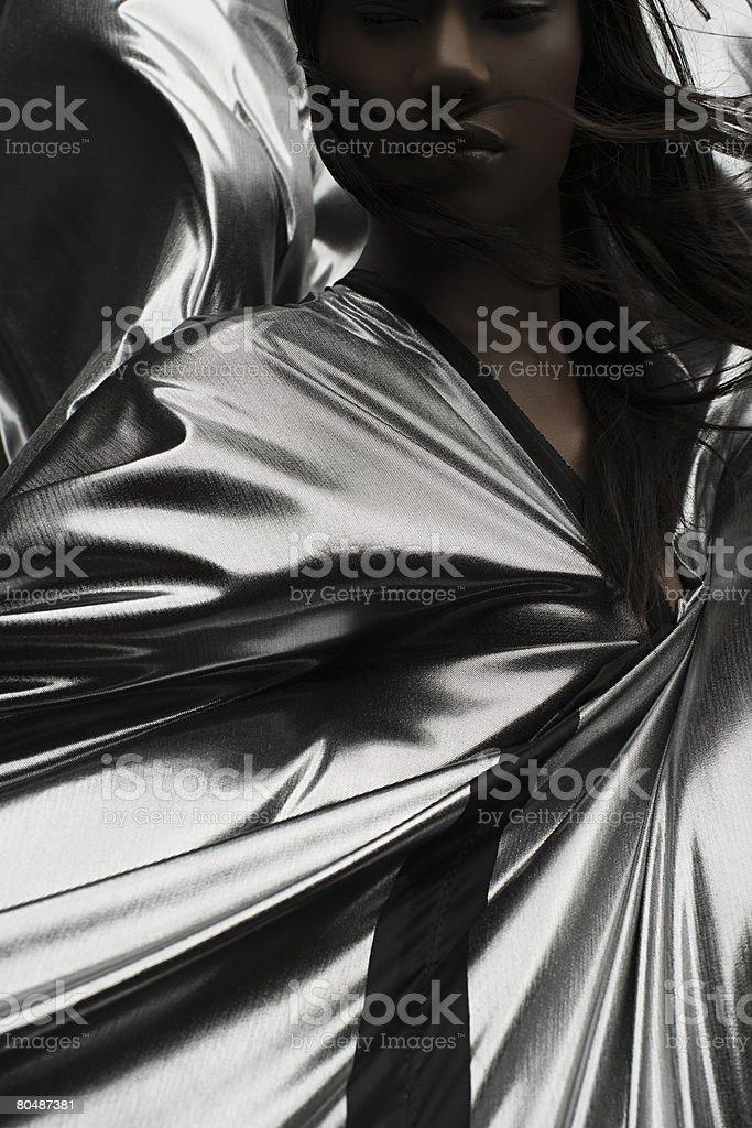 Portrait of a woman wearing silver dress 免版稅 stock photo