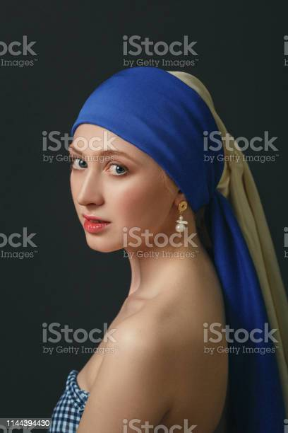 Portrait of a woman with a pearl earring inspired by the painting of picture id1144394430?b=1&k=6&m=1144394430&s=612x612&h=ogz bpxuyv5rfxemvumiz4hwvjzgjxx1akdwqxwurde=