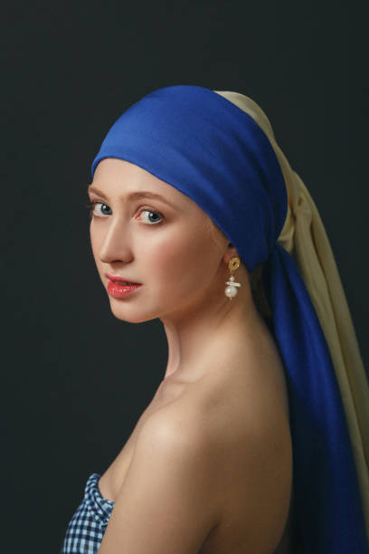 Portrait of a woman with a pearl earring, inspired by the painting of the great baroque and renaissance artist Jan Vermeer Portrait of a woman with a pearl earring, inspired by the painting of the great baroque and renaissance artist Jan Vermeer renaissance stock pictures, royalty-free photos & images