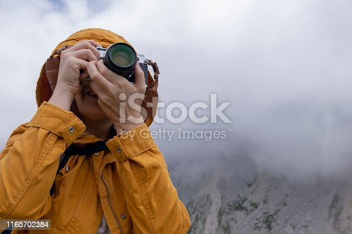 Women Looking At The View Of Mountain Mangart In Slovenian Alps