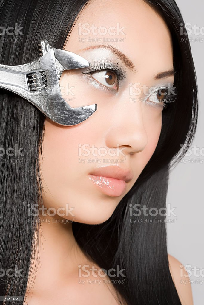Portrait of a woman with a spanner 免版稅 stock photo