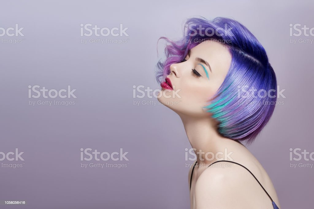 Portrait Of A Woman With Bright Colored Flying Hair All Shades Of