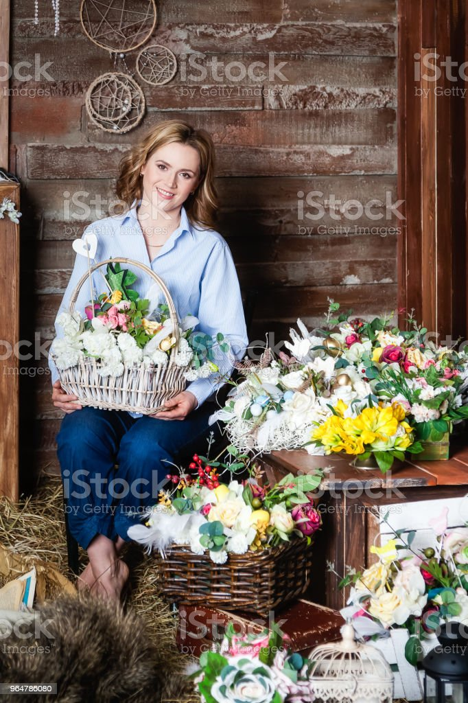 Portrait of a woman with flowers looking at the camera and smiling royalty-free stock photo