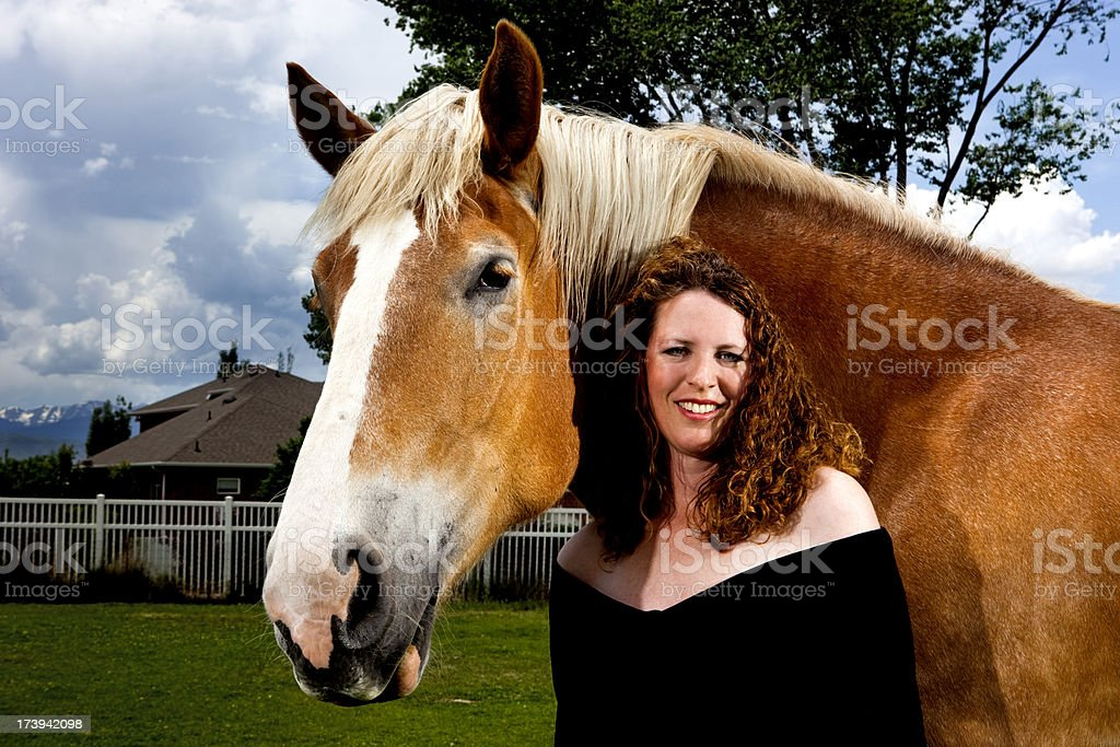 Portrait of a woman with her horse royalty-free stock photo