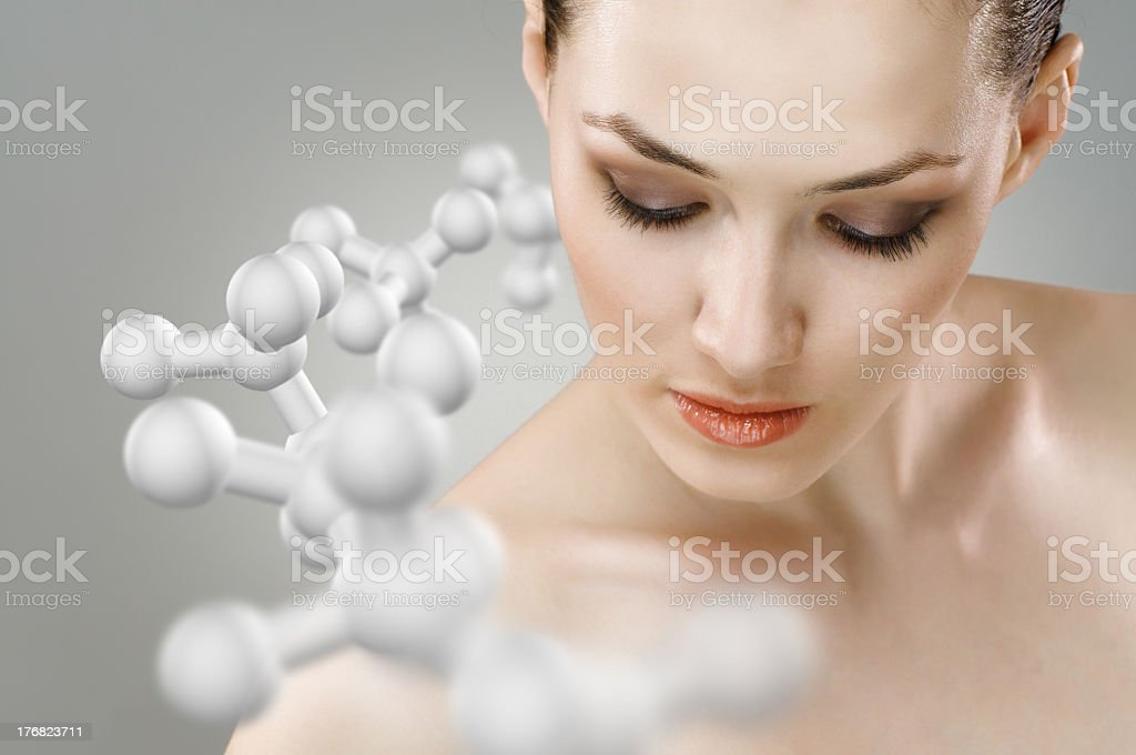 Portrait of a woman with molecules around her royalty-free stock photo