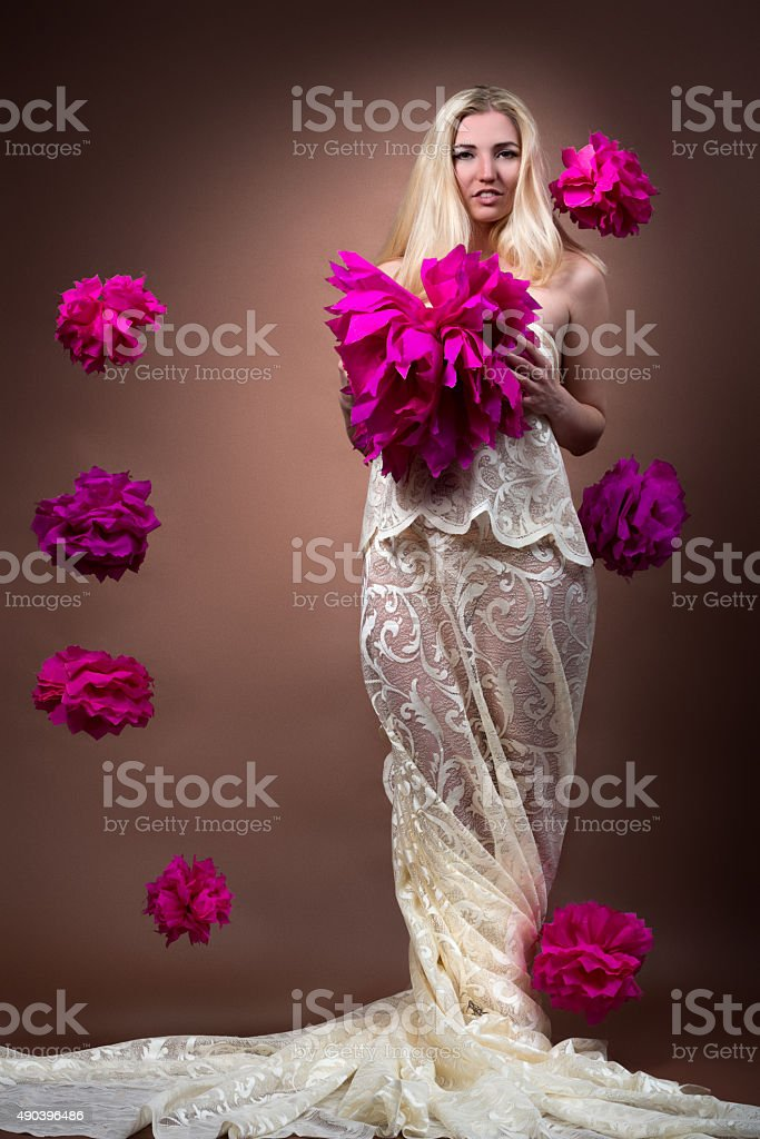 Portrait of a woman with paper flowers stock photo