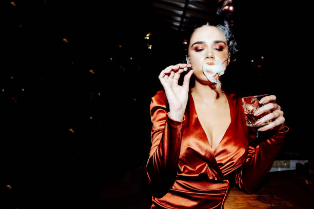 Portrait of a woman with the cigar stock photo