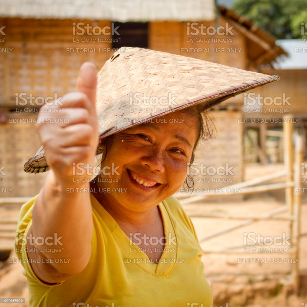 Portrait of a woman with traditional straw hat stock photo